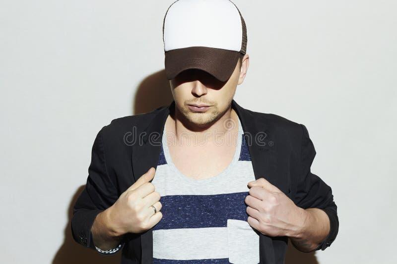 Fashionable Handsome Man in Cap. Stylish Boy in tracker hat.Young man. Fashionable Handsome Man in Cap. Stylish Boy in tracker hat. Casual Fashion.Young man stock photos