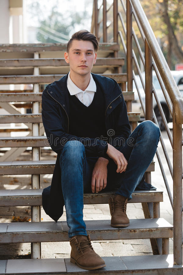 Fashionable handsome man model posing royalty free stock photo