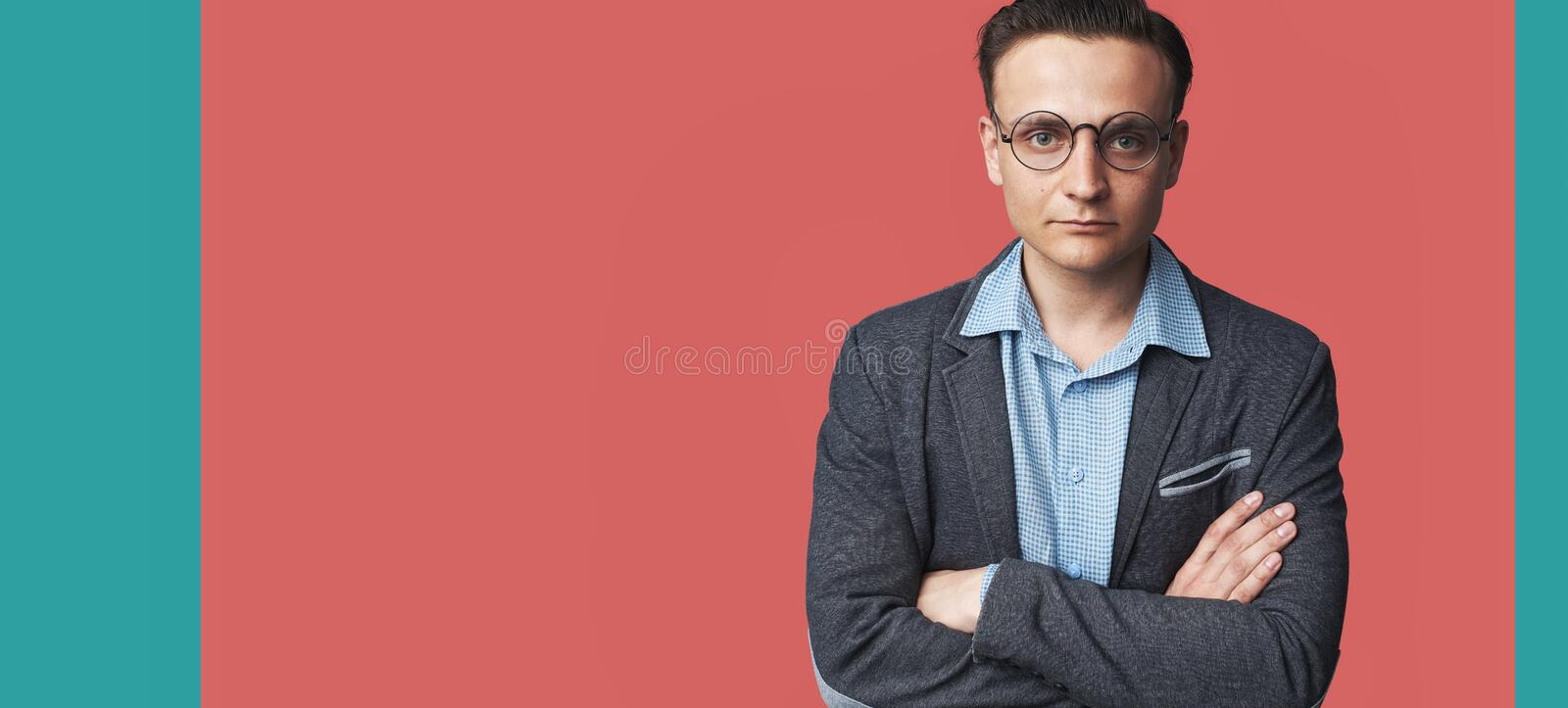 Fashionable handsome young man isolated on pink background stock photos