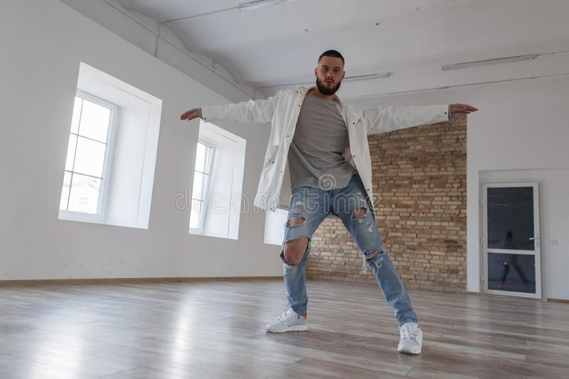Fashionable handsome young stylish man dancer in jacket royalty free stock images