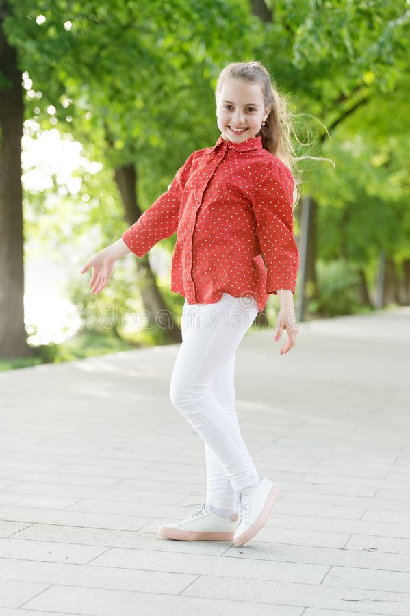 Always fashionable. Happy little child in fashionable wear on summer day. Adorable fashionable girl smiling on fresh air. Fashionable look of small vogue model royalty free stock photography