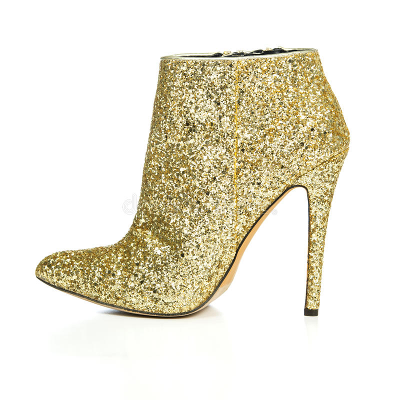 Fashionable High Heels ankle boots in sparkling gold royalty free stock images