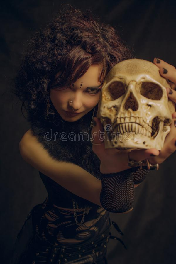 Fashionable kawaii witch with skull stock photo