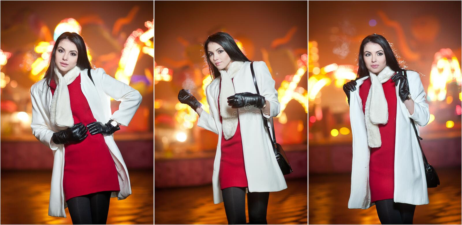 Fashionable lady wearing red dress and white coat outdoor in urban scenery with city lights in background. Full length portrait. Of young beautiful elegant stock photography