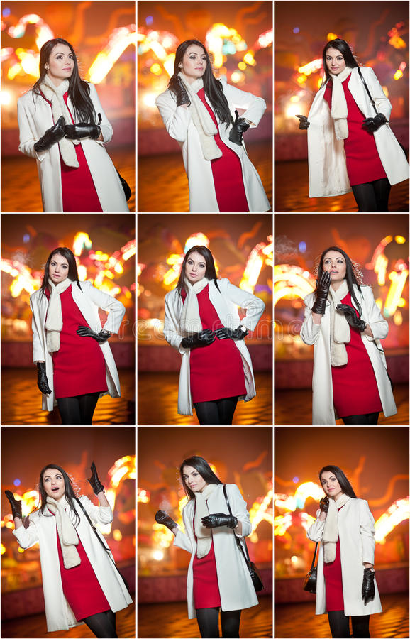 Fashionable lady wearing red dress and white coat outdoor in urban scenery with city lights in background. Full length portrait. Of young beautiful elegant royalty free stock image