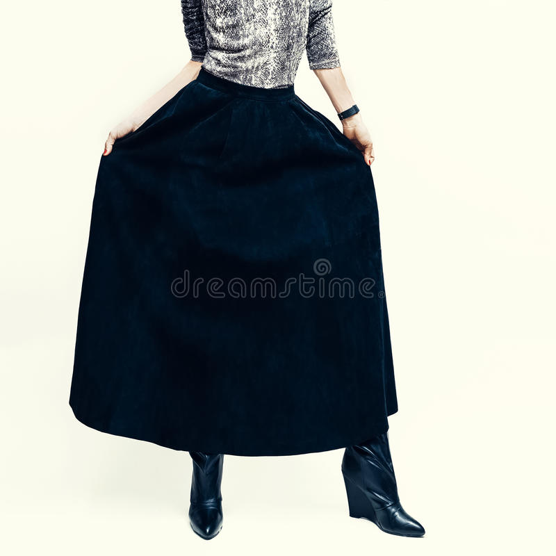 Fashionable leather skirt combined with snake print. Girl fashion style stock images