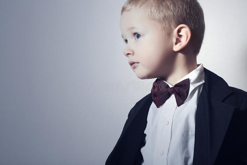Fashionable Little Boy in Bow tie.Stylish kid. fashion children. 4 Years Old Child in Black Suit. Portrait of Fashionable Little Boy in Bow tie.Stylish kid royalty free stock photography
