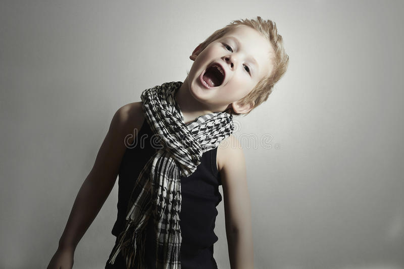 Fashionable little boy in scarf.fashion children. Funny Child royalty free stock photo