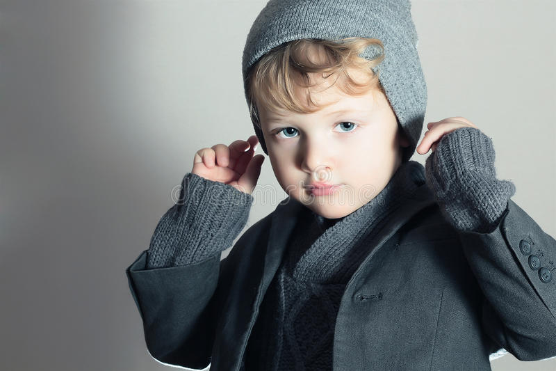 Fashionable Little Boy. Stylish Handsome Kid. Fashion Children. in suit, sweater and cap stock images