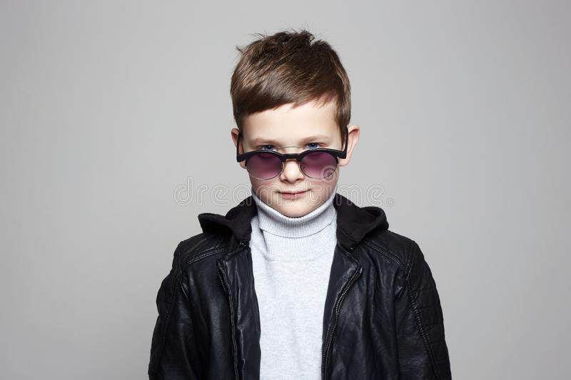 Fashionable little boy in sunglasses. stylish kid stock photos