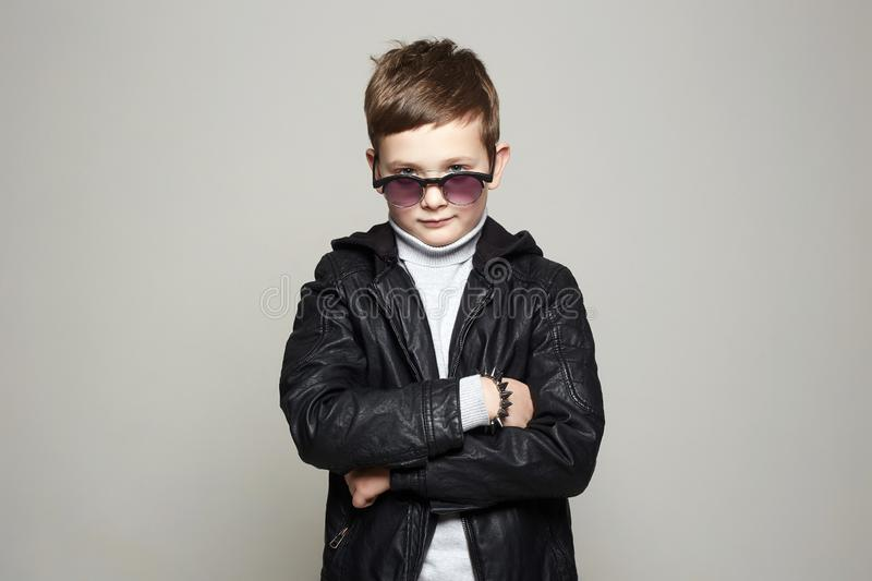 Fashionable little boy in sunglasses. stylish kid stock photo