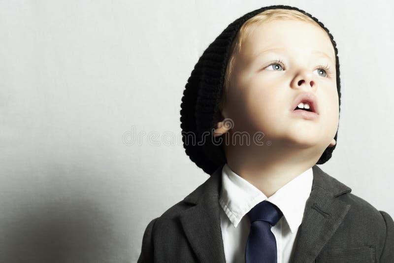 Fashionable little boy in tie.style kid. fashion children. Portrait of fashionable little boy in tie.style kid. fashion children.cap.suit royalty free stock image