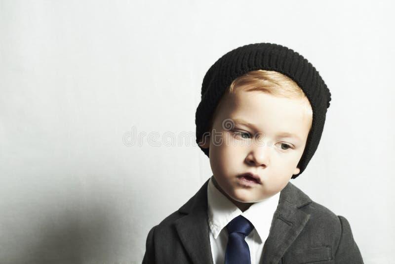 Fashionable little boy in tie.style kid. fashion children. Portrait of fashionable little boy in tie.style kid. fashion children.cap.suit stock image