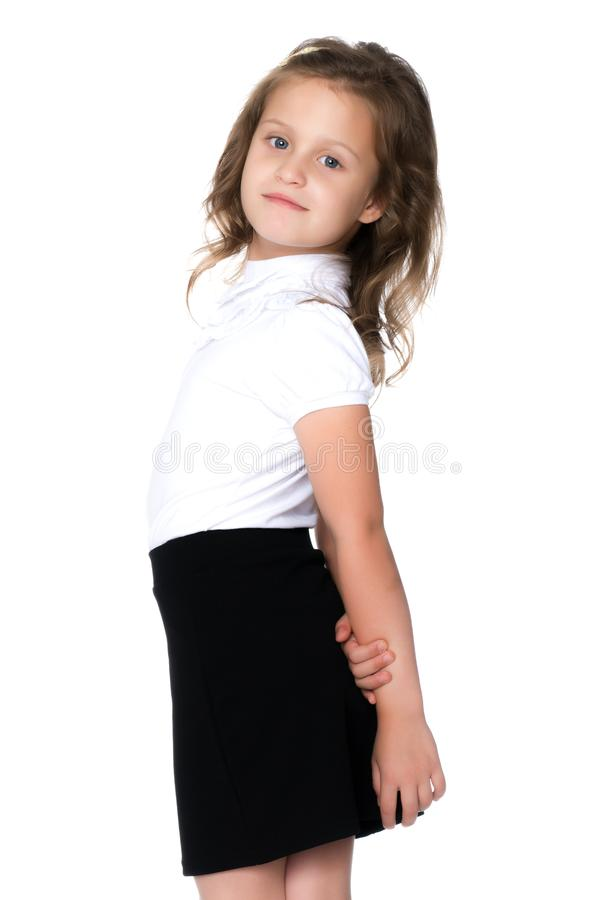 Fashionable little girl in a dress royalty free stock photography