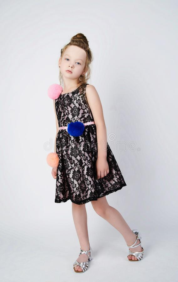 Fashionable little girl in dress stock images