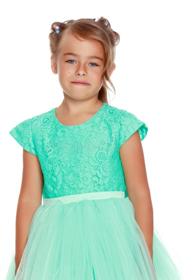 Fashionable little girl in a dress royalty free stock photos