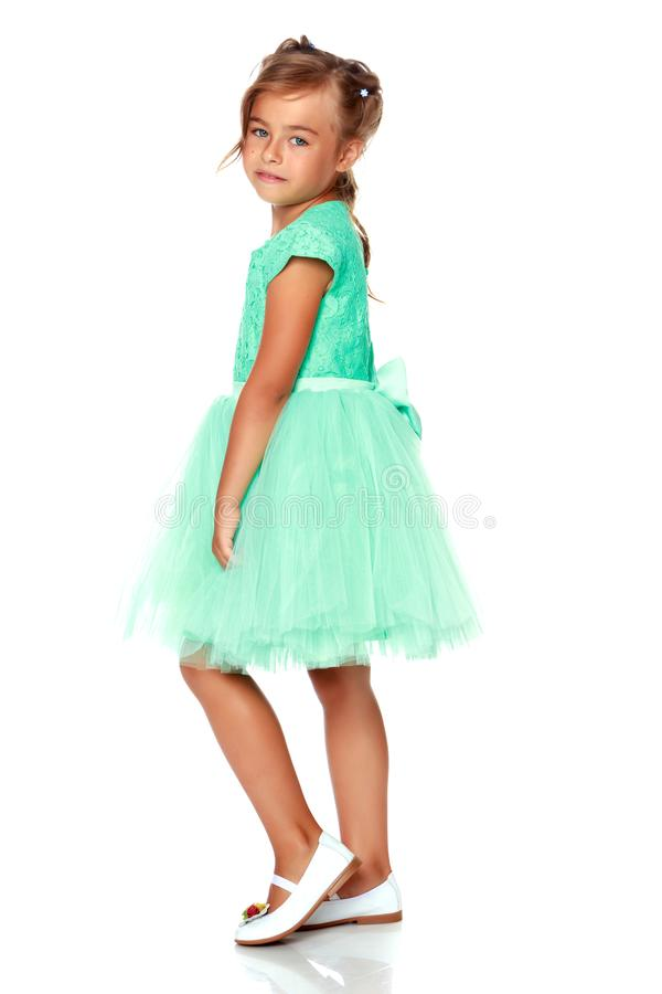 Fashionable little girl in a dress stock images