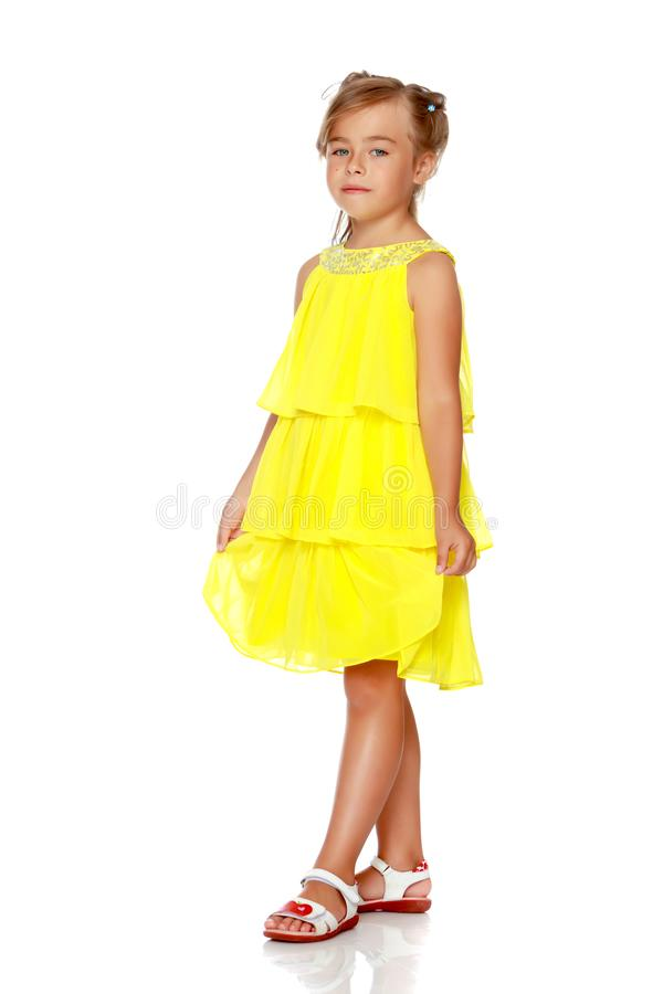 Fashionable little girl in a dress royalty free stock photo