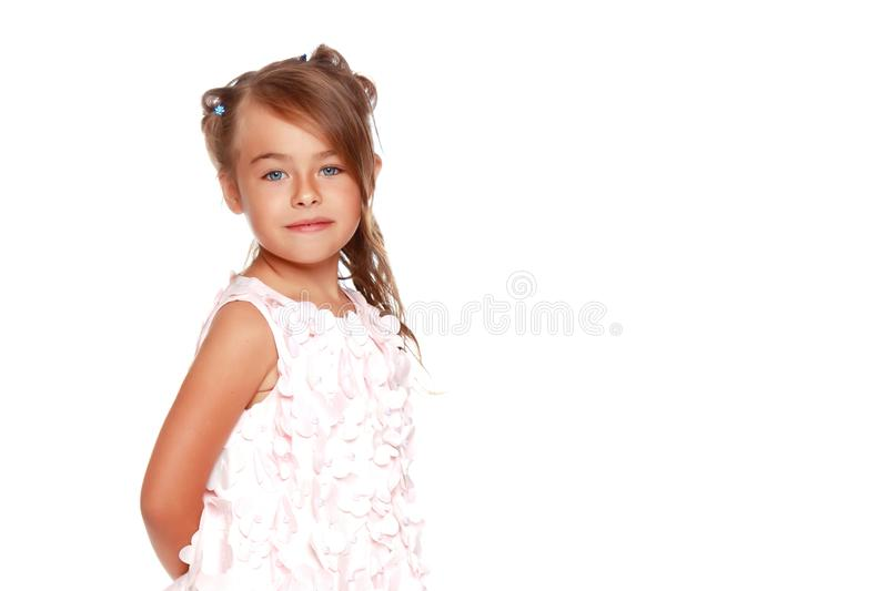 Fashionable little girl in a dress stock photography