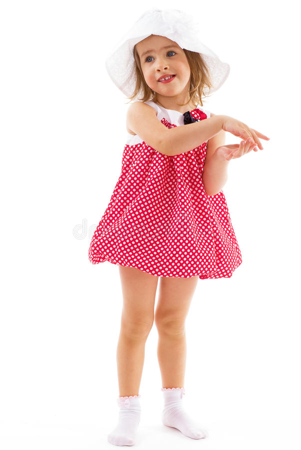 fashionable little girl in a pink dress stock photo