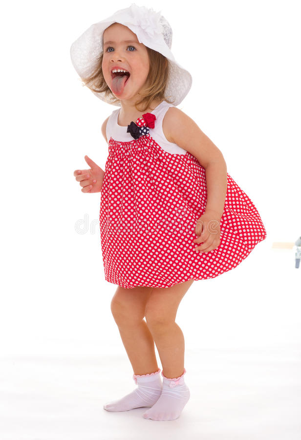 Fashionable little girl in a pink dress. royalty free stock image