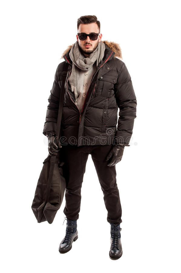 Fashionable male model wearing winter clothes and a big bag stock image