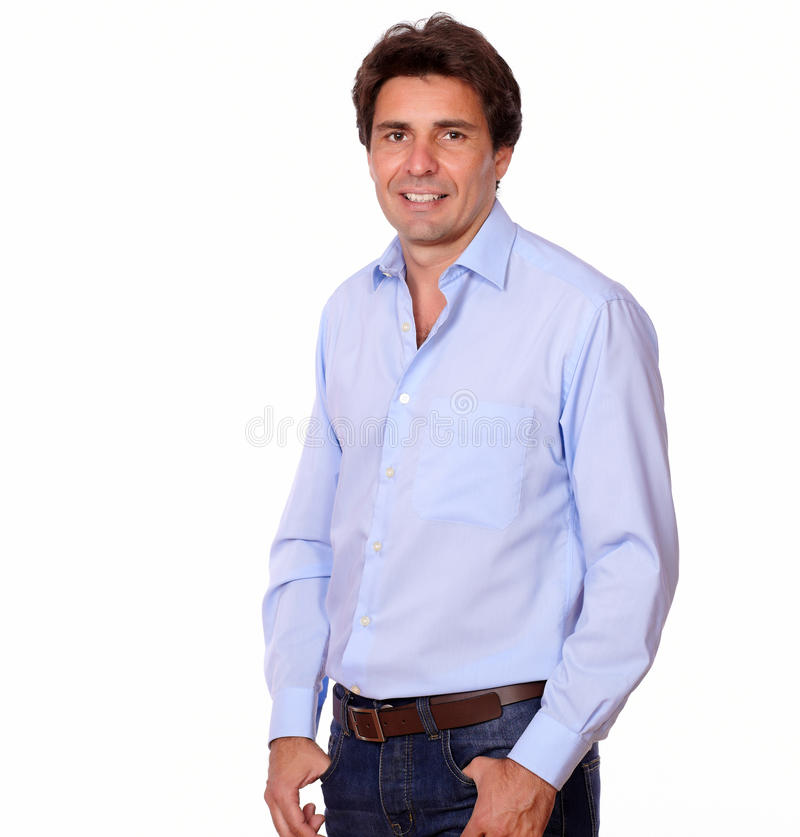 Fashionable man smiling at you while standing. Portrait of a fashionable man smiling at you while standing in white background stock photography
