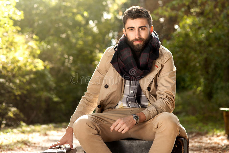 Fashionable men in autumn park. royalty free stock photo