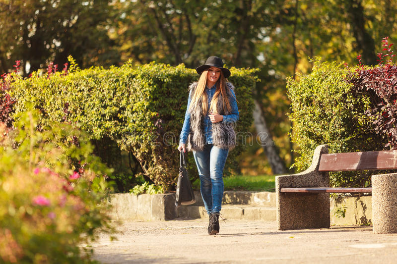 Fashionable model posing in park stock photography