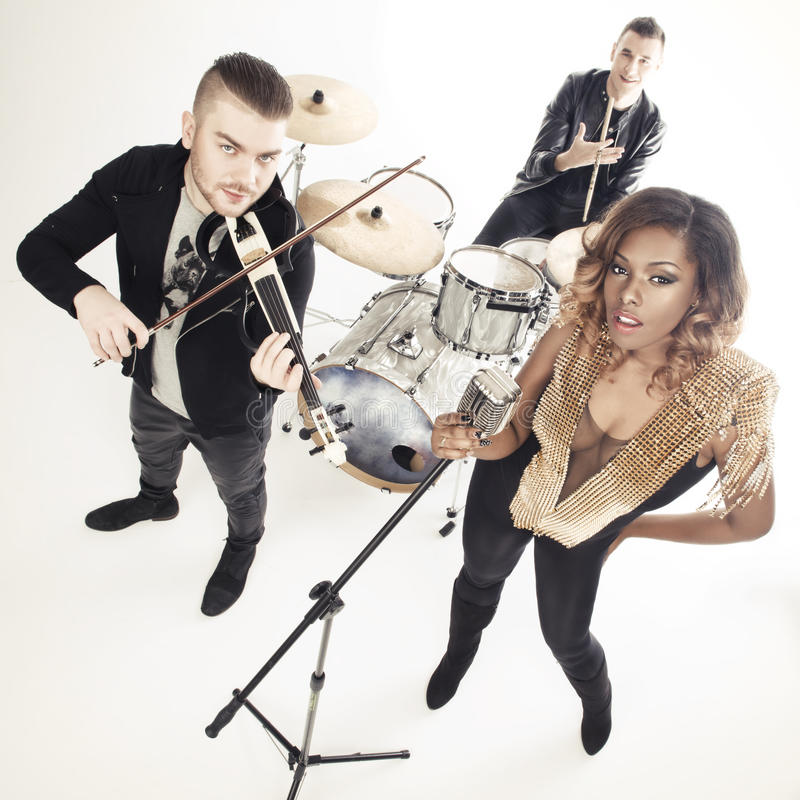 Fashionable music band posing. royalty free stock photography