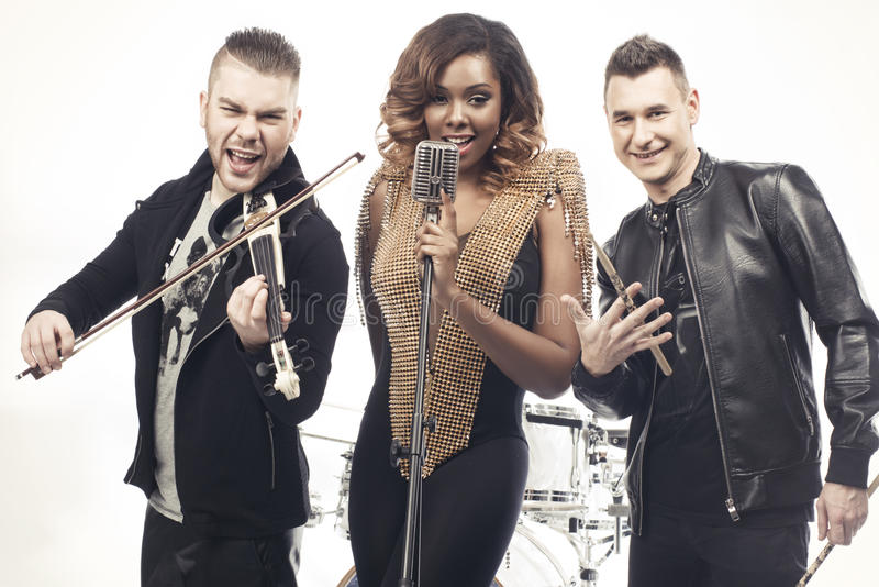 Fashionable music band posing. royalty free stock images