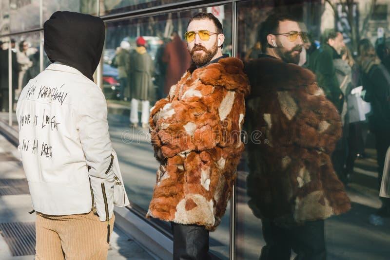 Fashionable people during Milan Men`s Fashion Week stock image