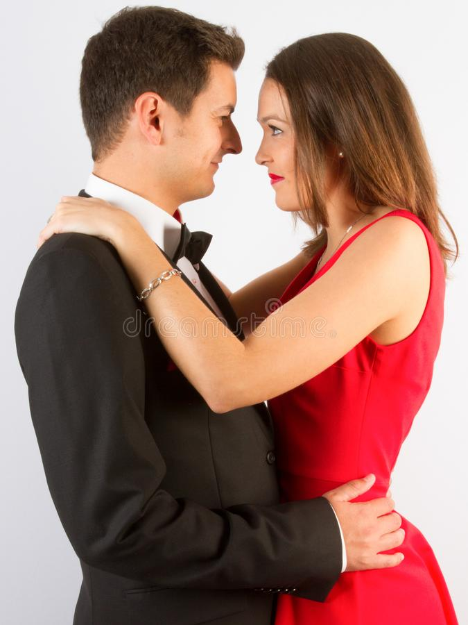 Fashionable picture of young people couple elegant kiss and hug stock images