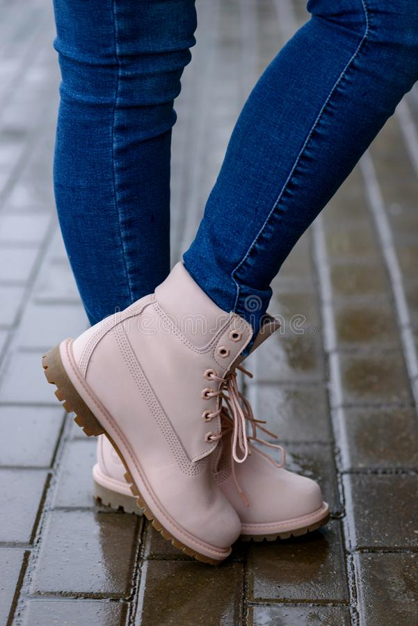 Fashionable pink boots on woman`s legs royalty free stock photos
