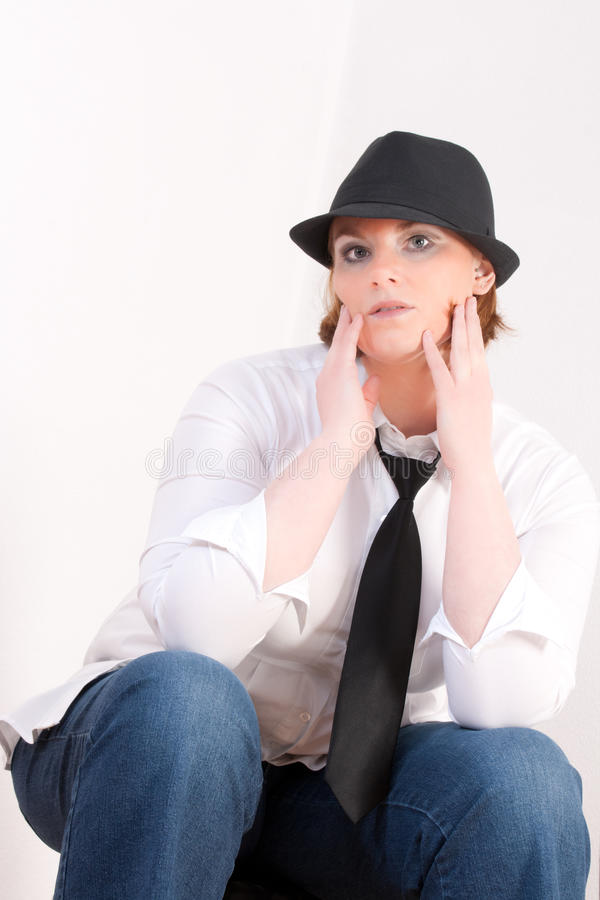Fashionable Plus Size Model. With a hat and tie stock image