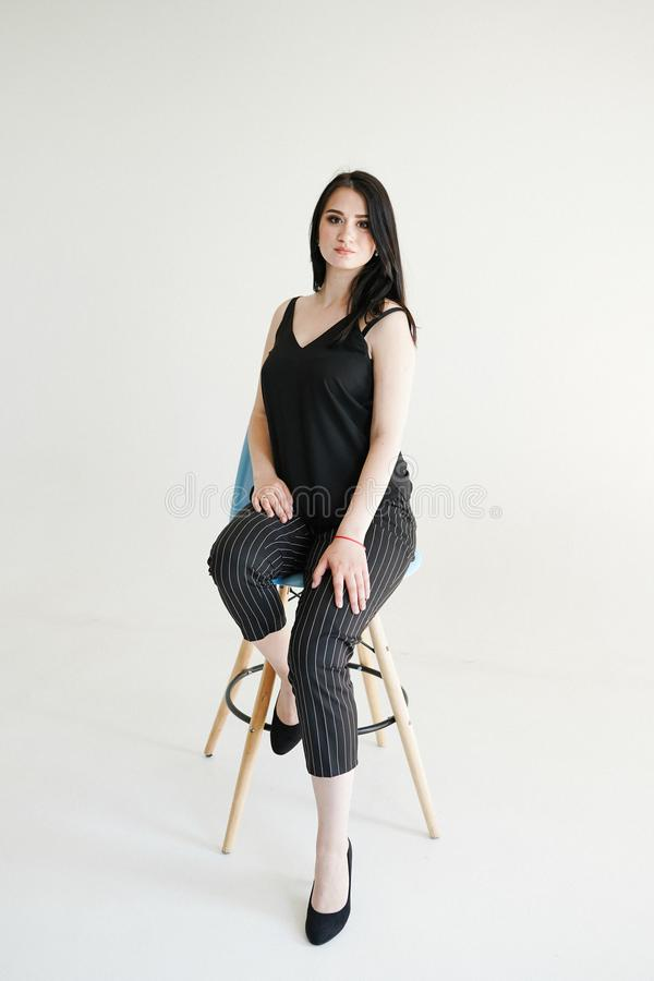Fashionable portrait of beautiful young business womanon white background with copy space royalty free stock photo