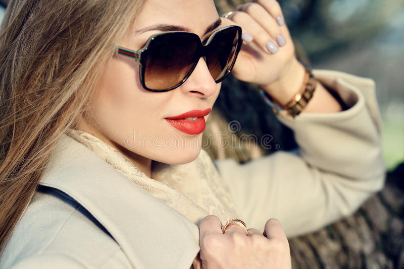 Fashionable portrait of lady with long hair in city stock photo