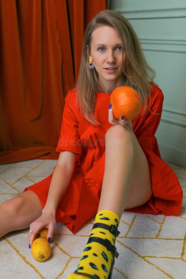 Fashionable portrait of stylish woman sitting on carpet stock photos