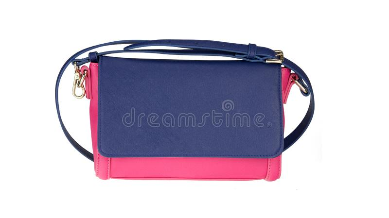 Fashionable red and blue female luxury women bag isolated on a white background. Fashionable womans accessories royalty free stock photo