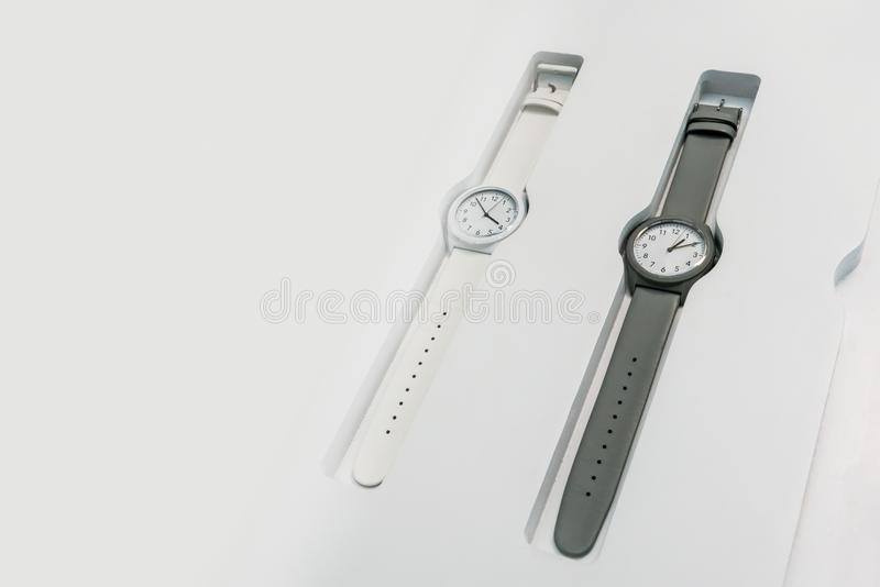 Fashionable round wrist watches with black and white collection stock photos