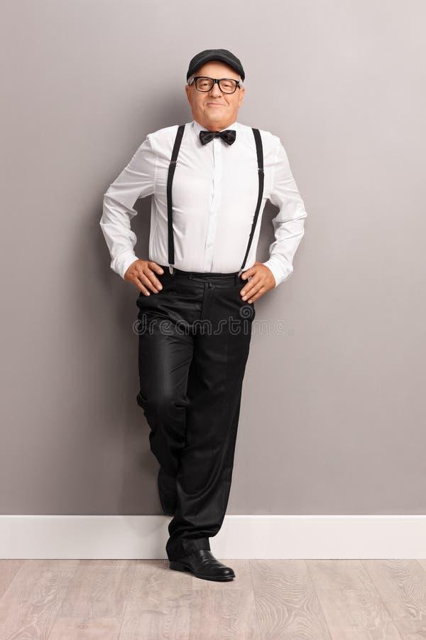 Fashionable senior gentleman with black suspenders stock image