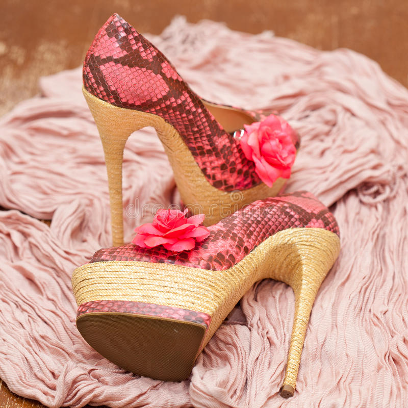 Fashionable shoes pink with pink flowers and a scarf stock photos