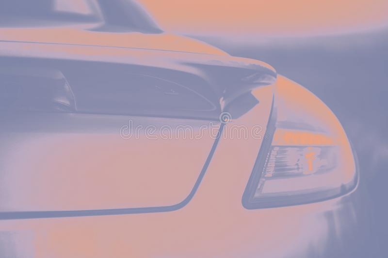 Fashionable sports car. Gray and orange peach color. Fragment automobile, details. Toned photo. Copy space royalty free stock photos