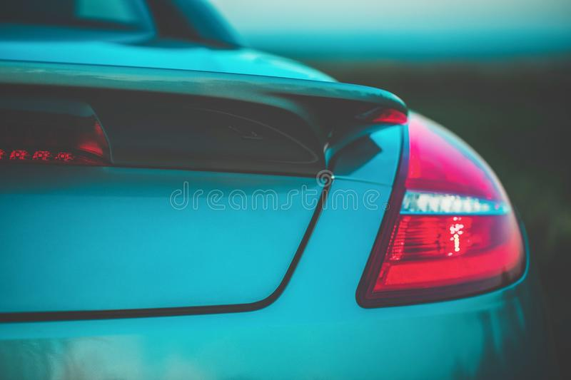 Fashionable sports turquoise car. Fragment, details. Evening light, toned photo stock photography