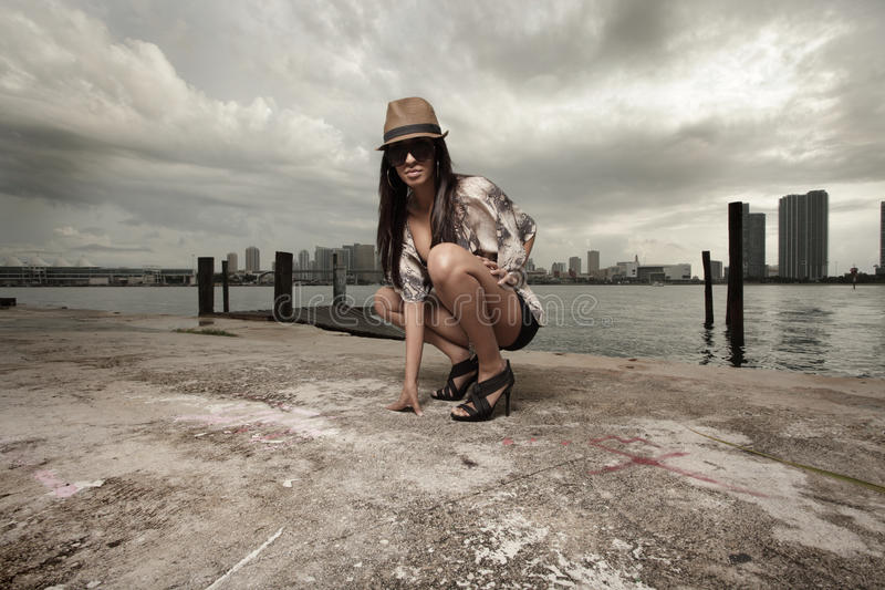 fashionable squatting woman στοκ φωτογραφίες