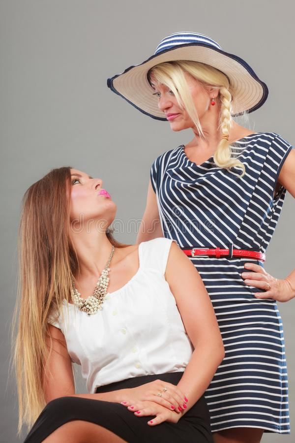Two women wearing fashionable dresses royalty free stock image