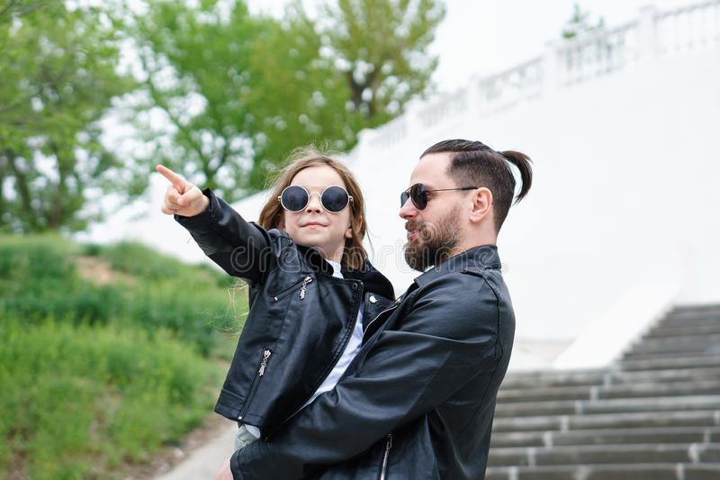 Dad and daughter walk around the city stock images
