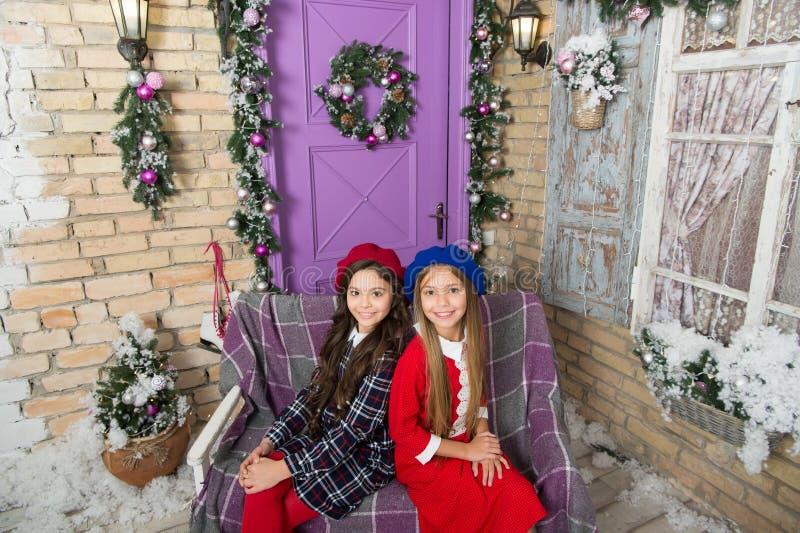 Fashionable and super comfortable. Cute children feel Christmas spirit. Little children on Christmas decoration. Girls stock photo