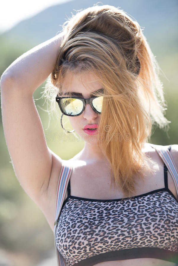 Fashionable super cute blond lady royalty free stock image