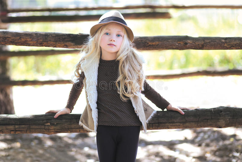 Fashionable teen girl, blonde. Country, rustic, ranch - style stock photography